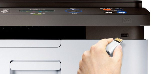 Someone is inserting the USB memory stick to Samsung Xpress C460W printer.
