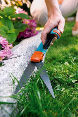 <strong>Temiz kesim</strong><br/>Yapışmaz maddeyle kaplı bıçaklar temiz bir kesim sağlar.